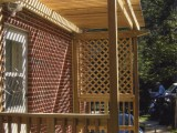 Side view of trellis style porch made of pressure treated lumber for kitchen exterior entrance at home on University Boulevard, Silver Spring, MD.