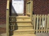 Exterior stairs built from pressure treated lumber leading to the kitchen at home on Seminary Road, Silver Spring, MD.