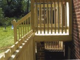 Side view (right) of exterior stairs built from pressure treated lumber leading to the kitchen at home on Seminary Road, Silver Spring, MD.