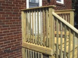 Side view of exterior stairs with close up view of deck railing made of pressure treated lumber at home on Seminary Road, Silver Spring, MD