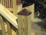 Close up of anchor post of stairs built from pressure treated lumber leading to the kitchen at home on Seminary Road, Silver Spring, MD.