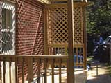 Trellis style porch built for exterior kitchen entrance for home on university Boulevard in Silver Spring, MD.